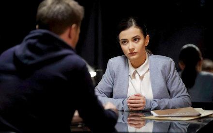 woman investigating a man