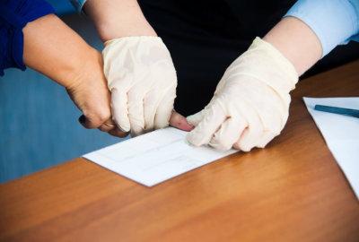 man examining his client fingerprint