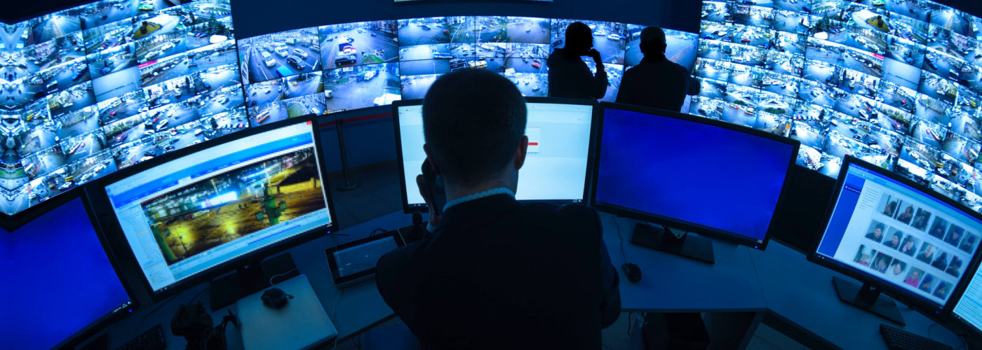 men monitoring the cctvs
